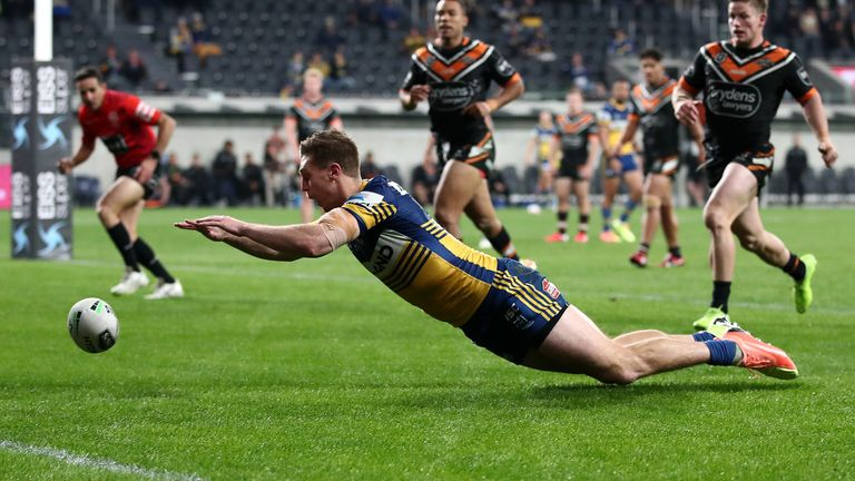 Shaun Lane dives to score for the Eels