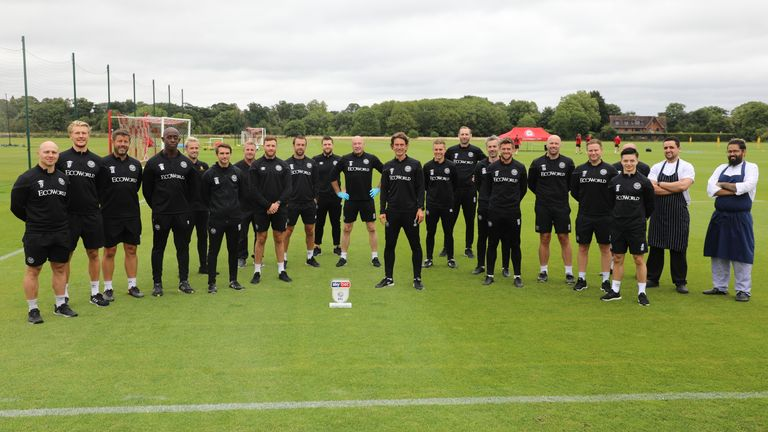 Thomas Frank poses with his staff after the Brentford boss won June Manager of the Month in the Championship