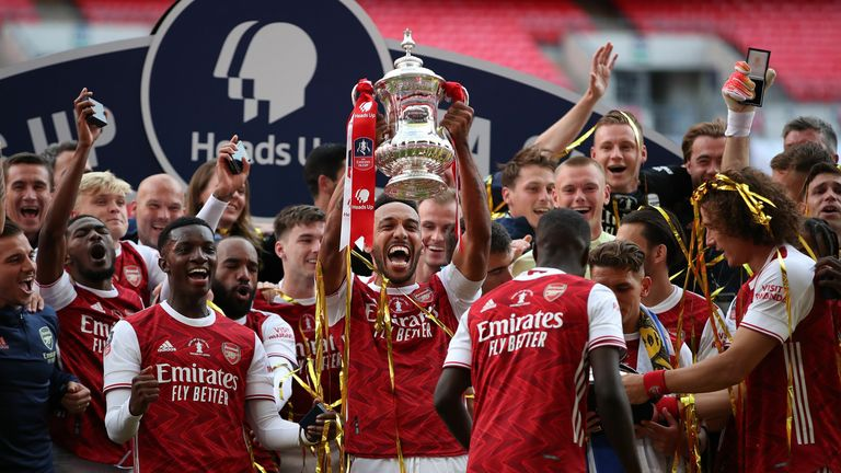 Pierre-Emerick Aubameyang lifts the FA Cup after his double inspired Arsenal to a 2-1 victory over Chelsea at Wembley