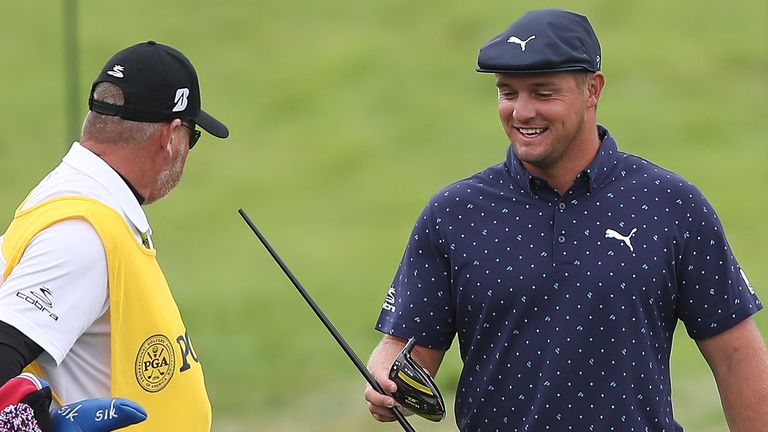 DeChambeau lent on his driver as he went to pick up his tee