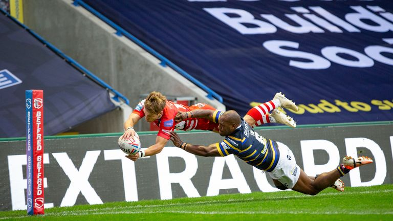 Salford's Josh Johnson is prevented from scoring a try by Rob Lui