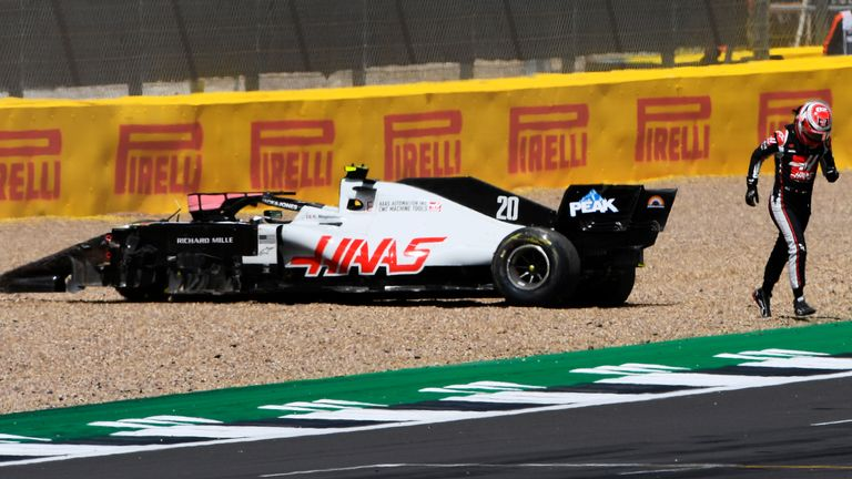 Haas' Kevin Magnussen is forced out of the British Grand Prix after making contact with Red Bull's Alex Albon.