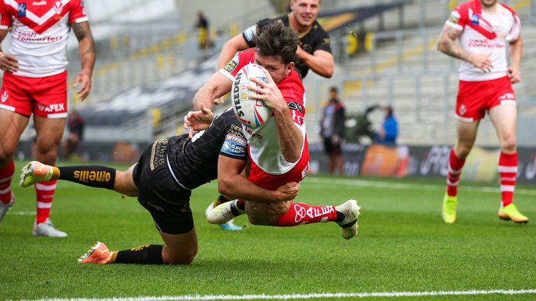Lachlan Coote  stretches to score his side's first try