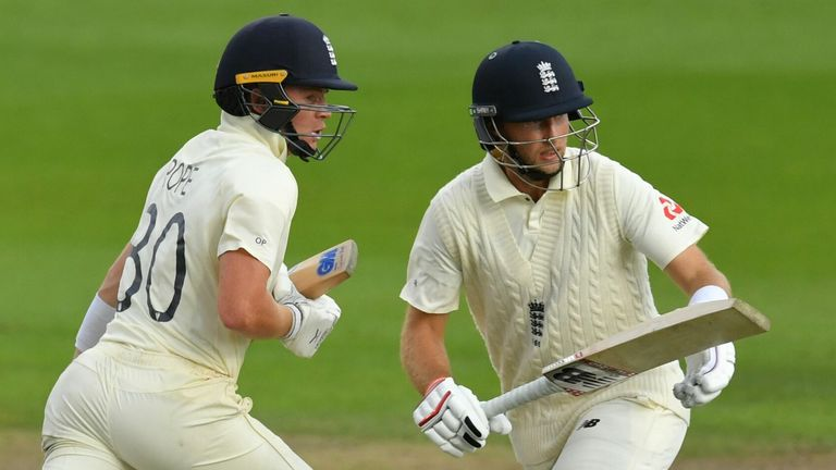 England's Ollie Pope (L), batting with skipper Joe Root (R), was awarded his first central contract in September
