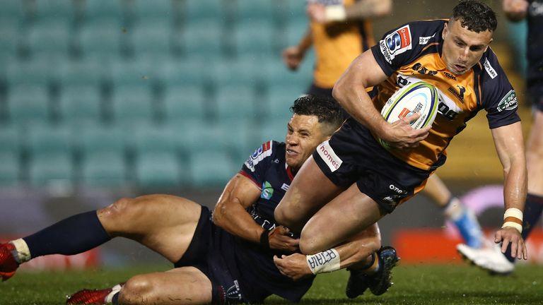 Brumbies full-back Tom Banks is tackled by Matt Toomua