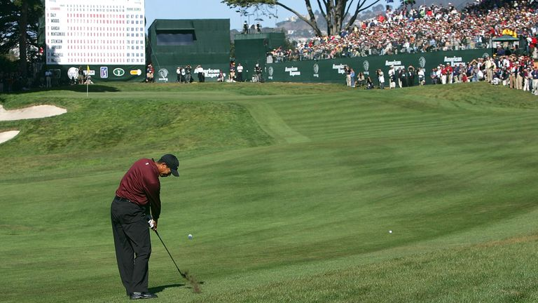 Woods hits his approach shot on the 18th hole during the play-off