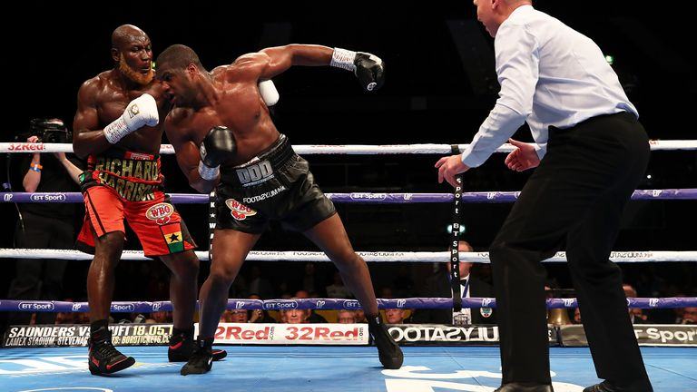 Dubois got into a reckless brawl before eventually beating Lartey