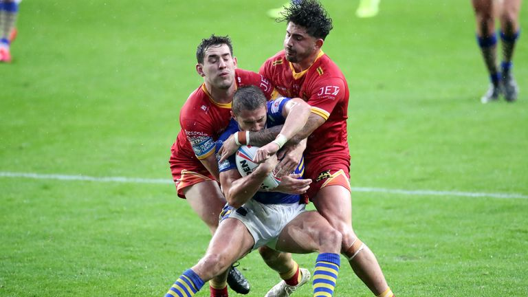 Leeds Rhinos' Jack Walker is wrapped up by Catalans tacklers