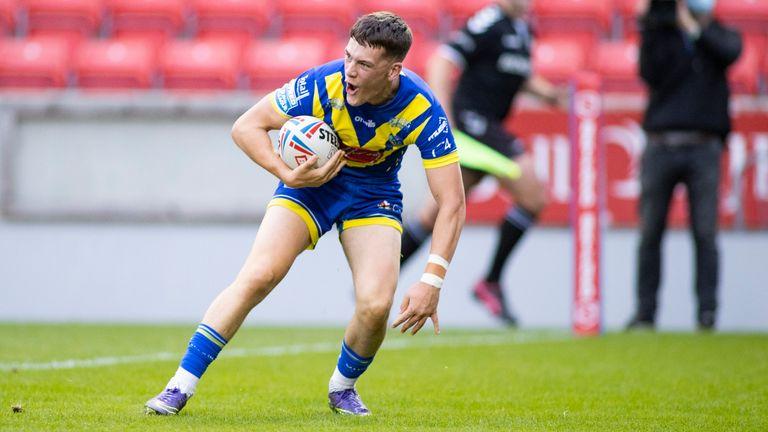 Josh Thewlis celebrates his try for Warrington