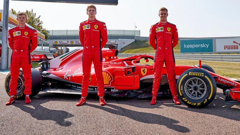 Left to right: Callum Ilott, Robert Shwartzman and Schumacher with Ferrari's race-winning 2018 car