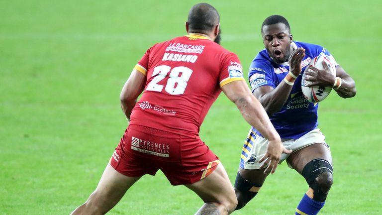 Muizz Mustapha tries to get past Catalans Dragons' Sam Kasiano