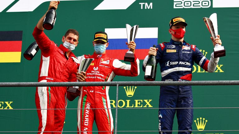 Robert Shwartzman (R) and Mick Schumacher (C) celebrate their respective victory and second place in last Sunday's F2 sprint race at Spa-Francorchamps