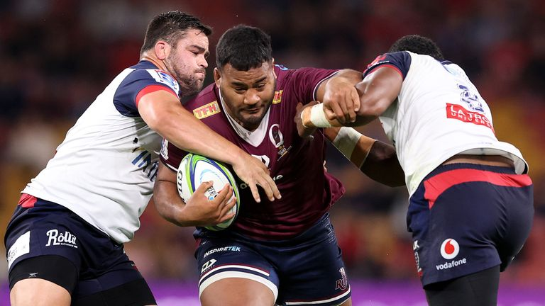 Reds prop Taniela Tupou takes on the Rebels defence