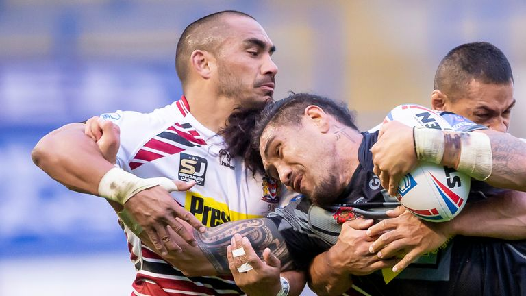 Tommy Leuluai is a big presence in Wigan's right-side defence