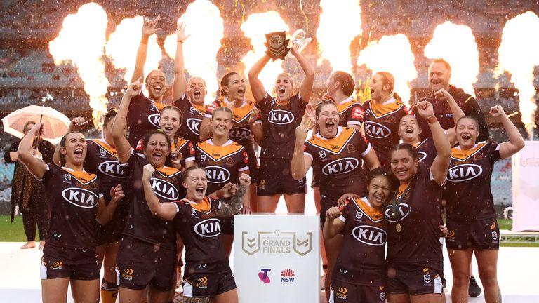 Brisbane celebrate winning their third NRLW title in a row