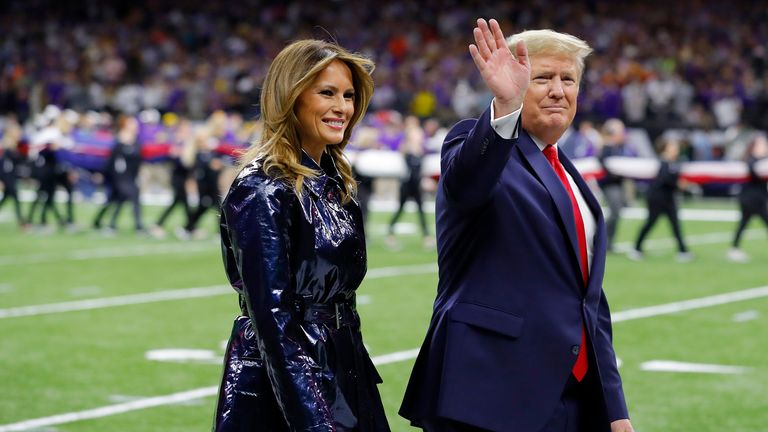 Trump and First Lady Melania Trump at the College Football Playoff National Championship game between the Clemson Tigers and the LSU Tigers in January