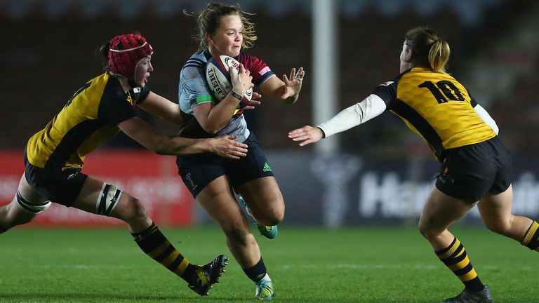 Harlequins' Ellie Green runs at the Wasps defence - the two sides will square off next week in the Premier 15s