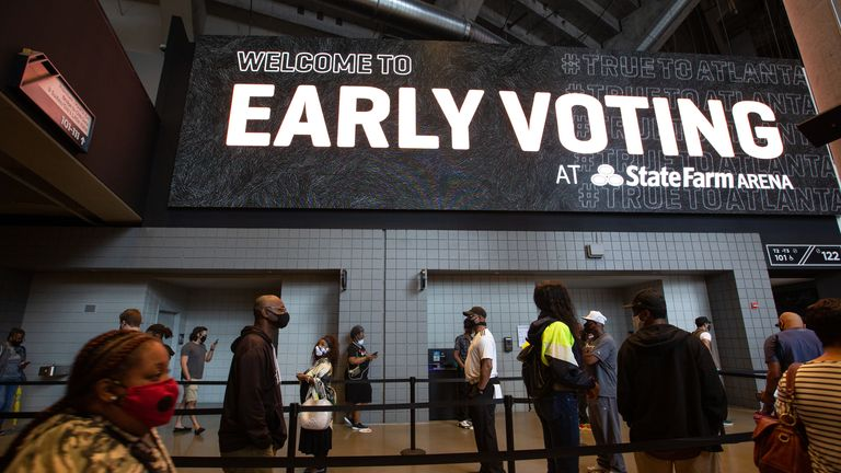 Voters line up inside State Farm Arena, Georgia's largest early voting location, on the first day of early voting