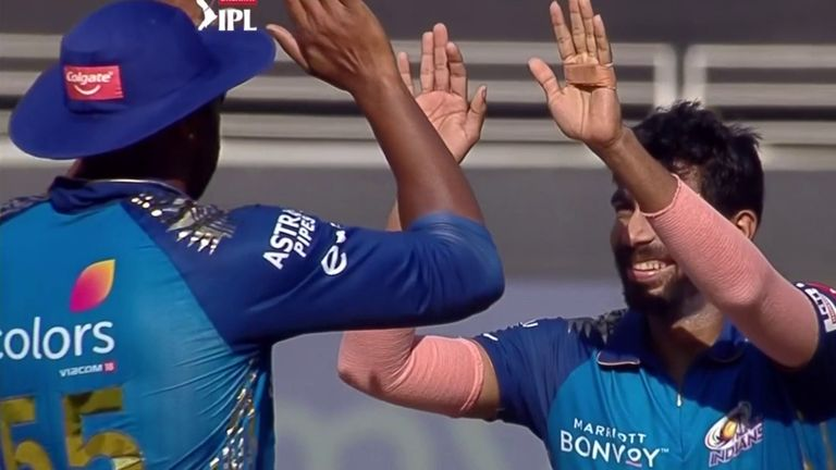 Jasprit Bumrah (right) bagged three wickets in another inspired spell for Mumbai Indians