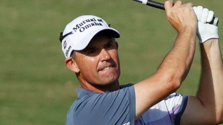 Padraig Harrington carded a 71 to stay four behind