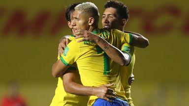 Roberto Firmino (right) is congratulated after scoring Brazil's winner against Venezuela