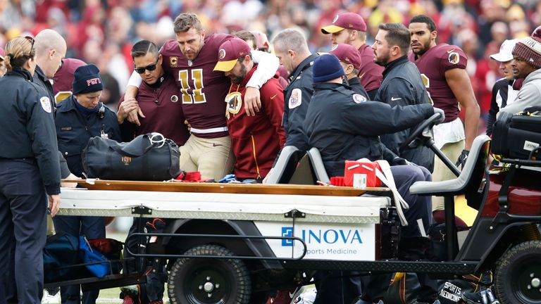 Alex Smith is helped off the field after his devastating leg injury