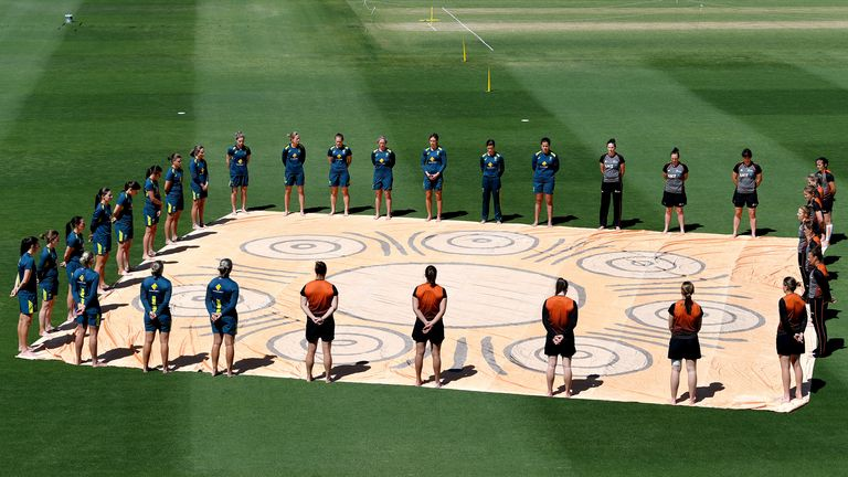 Players from both teams stand in solidarity for 'Close The Gap' in awareness of the gap between Indigenous and Non Indigenous Australians, before game one of the T20 Women's International series between Australia and New Zealand