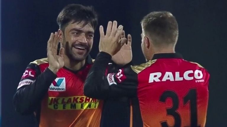 Rashid Khan (L) and David Warner have played key roles in Sunrisers Hyderabad's surge into the IPL play-offs