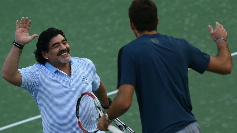 Football legend Diego Maradona (left) greets his fellow countryman Juan Martin del Potro in 2013