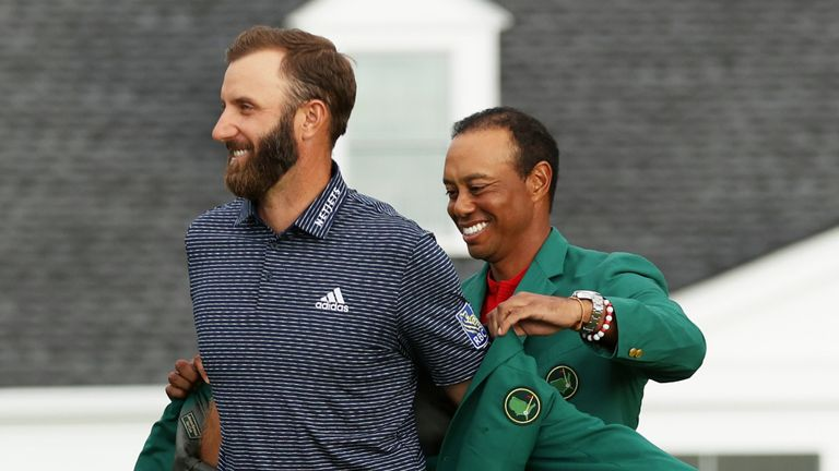 Dustin Johnson was presented with the Green Jacket by five-time Masters champion Tiger Woods