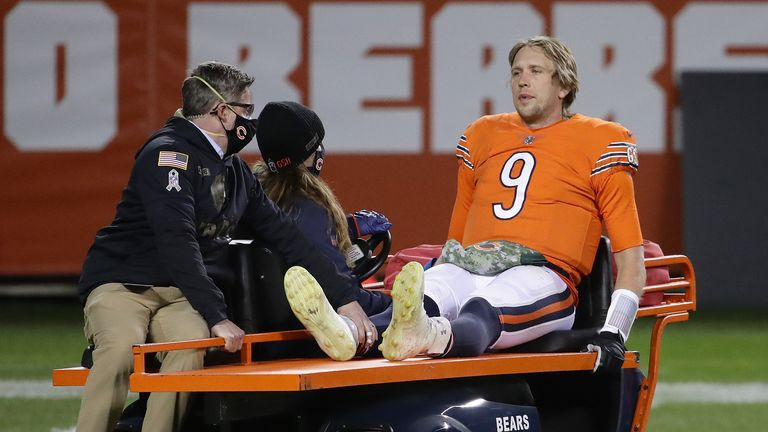 Nick Foles is carted off after injuring his hip against the Vikings in Week 10