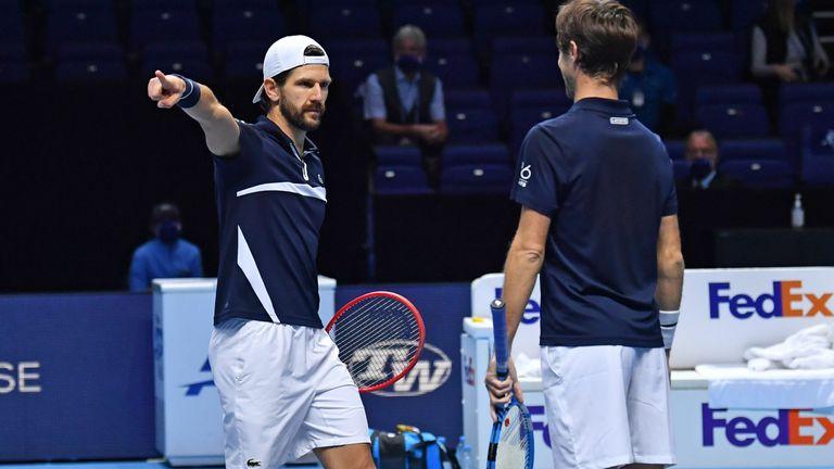 Melzer (left) celebrates reaching the doubles final alongside Roger-Vasselin
