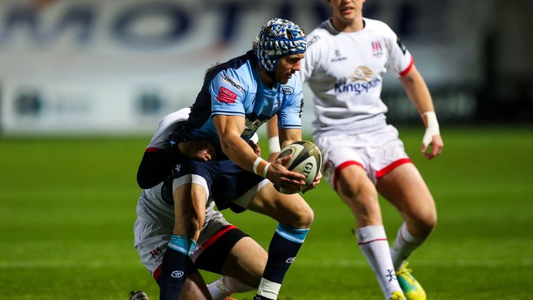 Matthew Morgan of Cardiff Blues is tackled by Louis Ludik