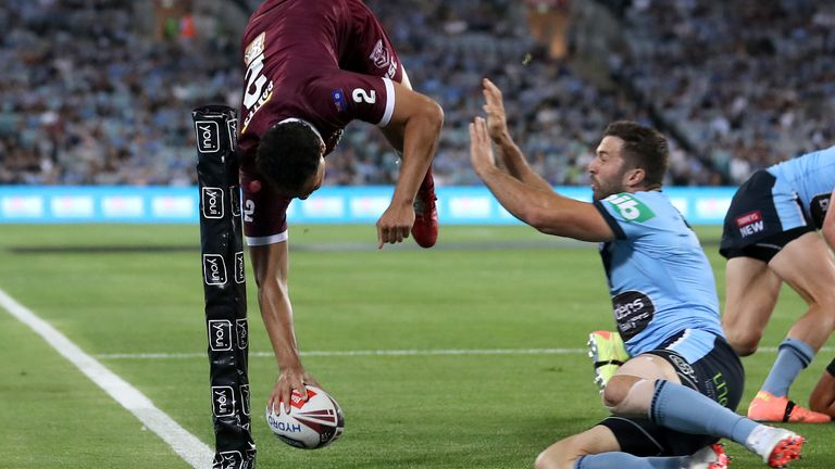 Xavier Coates shows his incredible acrobatic skills to score for the Maroons