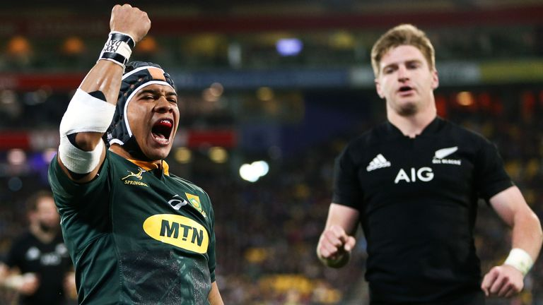 Cheslin Kolbe celebrates after scoring a try against the All Blacks in Wellington