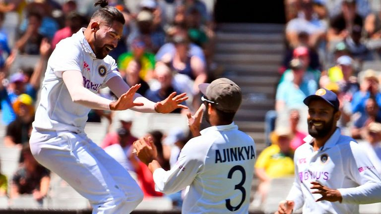 Mohammed Siraj (L) celebrates his first Test wicket with India's stand-in captain Ajinkya Rahane after dismissing Australia's Marnus Labuschagne