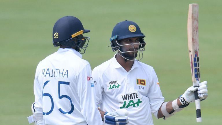 Dasun Shanaka from Sri Lanka raises his bat after receiving his Virgin Test 50 at Centurion