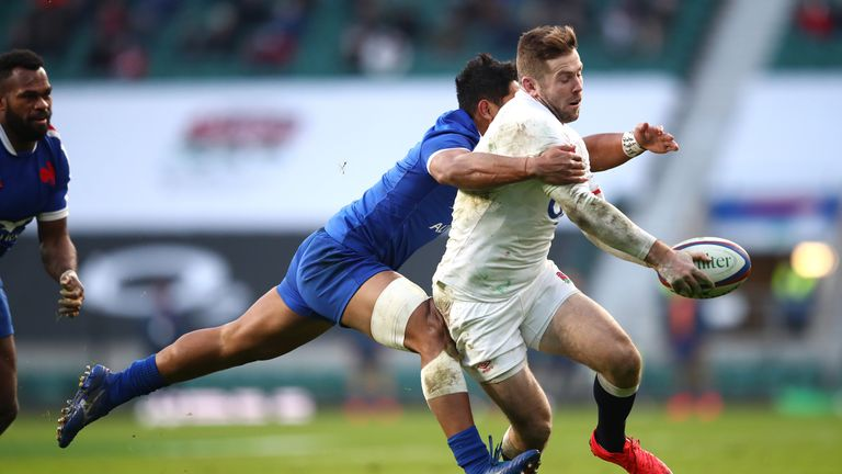 Elliot Daly of England is tackled by Yoram Moefana