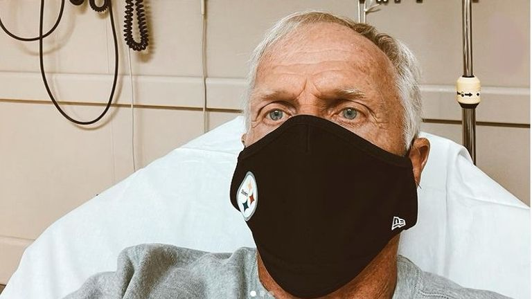 Greg Norman posted a photo on Instagram of her wearing a mask and lying on a hospital bed