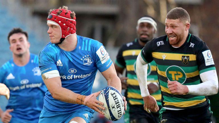 Josh van der Flier looks to offload as Northampton's Nick Isiekwe hunts him down