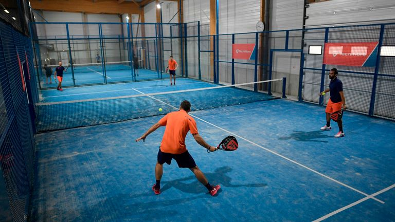People play a padel match in Bois d'Arcy near Paris