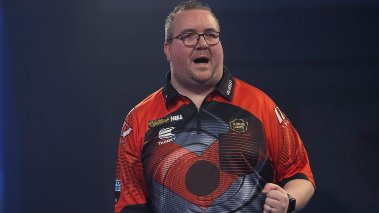 Bunting's average of 05 against Daryl Gurney is his highest in his World Grand Prix career (Lawrence Lastig / PDC).