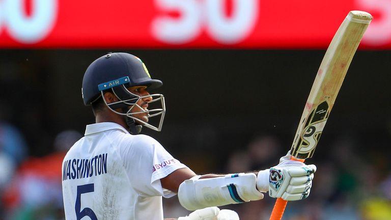 India's Washington Sundar raises his bat after reaching his maiden Test 50 at the Gabba