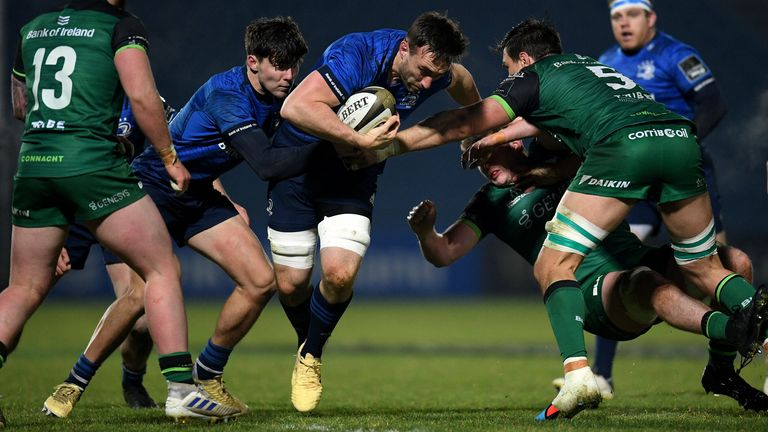 Jack Conan of Leinster is tackled by Connacht's Quinn Roux
