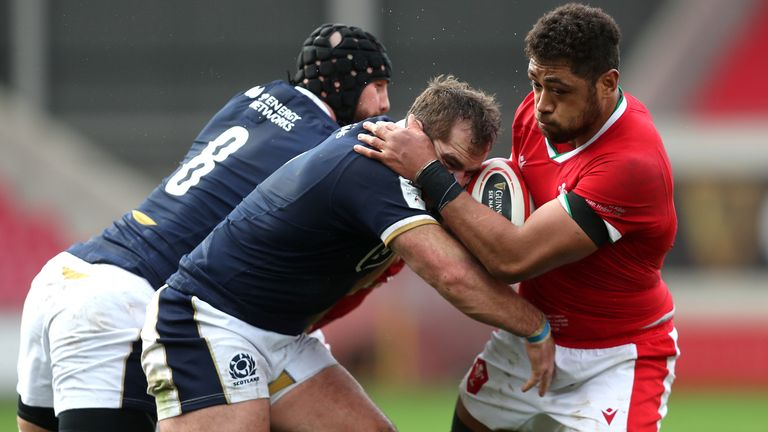 Wales' Tatulupe Faletau (right) is tackled by Scotland's Blade Thomson (left) and Fraser Brown during the Guinness Six Nations match at Parc y Scarlets, Llanelli