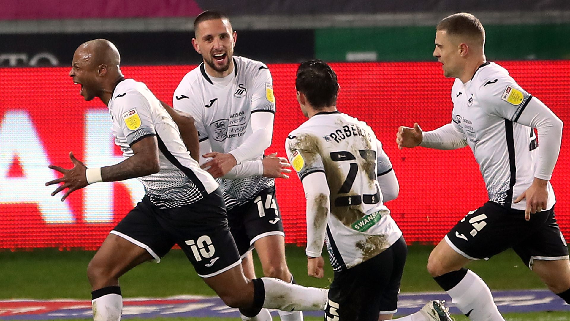 Swansea beat Norwich to move two points behind leaders