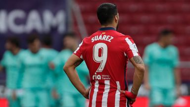 Luis Suarez looks on as Levante celebrate against Atletico Madrid