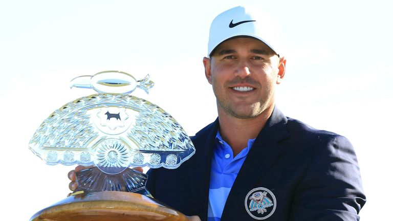 Brooks Koepka displays the trophy after winning the Phoenix Open at TPC Scottsdale