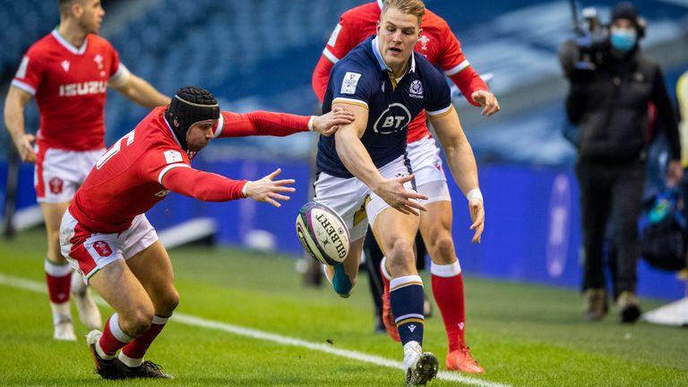 Duhan van der Merwe evades the tackle of Wales' Leigh Halfpenny