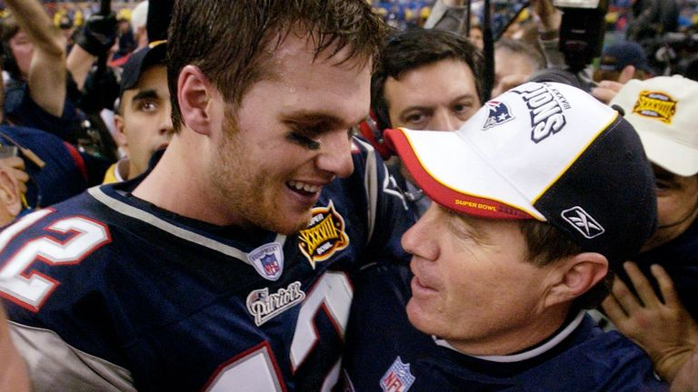 Tom Brady and Patriots head coach Bill Belichick celebrate their Super Bowl XXXVIII win over Carolina